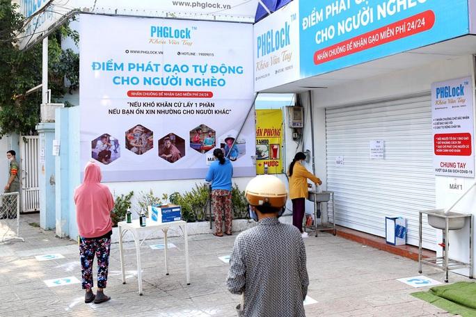 """Báo nước ngoài đưa tin về """"ATM gạo"""" của Việt Nam - Ảnh 2."""