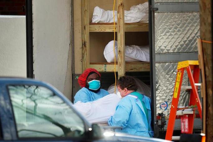 Mỹ: Hơn 23.000 người chết vì Covid-19, 9 bang chuẩn bị nới lỏng phong tỏa - Ảnh 1.