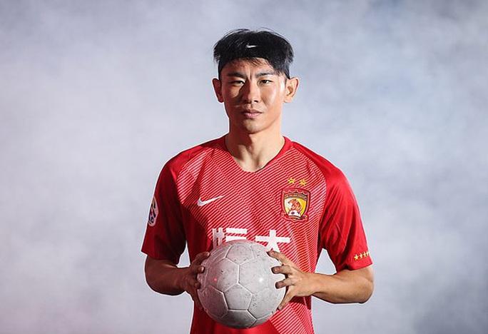 Gian lận biển số xe, tuyển thủ Trung Quốc bị Quảng Châu Evergrande sa thải - Ảnh 4.