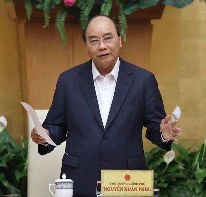Thủ tướng: Hà Nội, TP HCM và 26 tỉnh, thành tiếp tục thực hiện nghiêm Chỉ thị 16 - Ảnh 1.