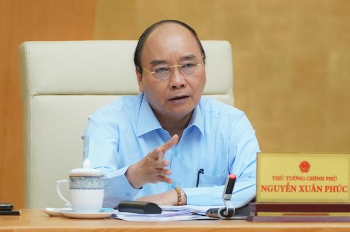 Thủ tướng: Chấn chỉnh những lệch lạc trong xuất khẩu gạo, xử lý nghiêm sai phạm - Ảnh 1.