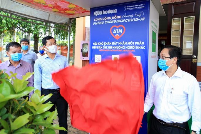 Báo Người Lao Động khai trương ATM thực phẩm miễn phí thứ 2 - Ảnh 1.