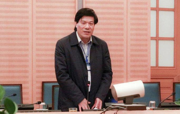 Bắt Giám đốc Trung tâm Kiểm soát bệnh tật Hà Nội Nguyễn Nhật Cảm - Ảnh 1.