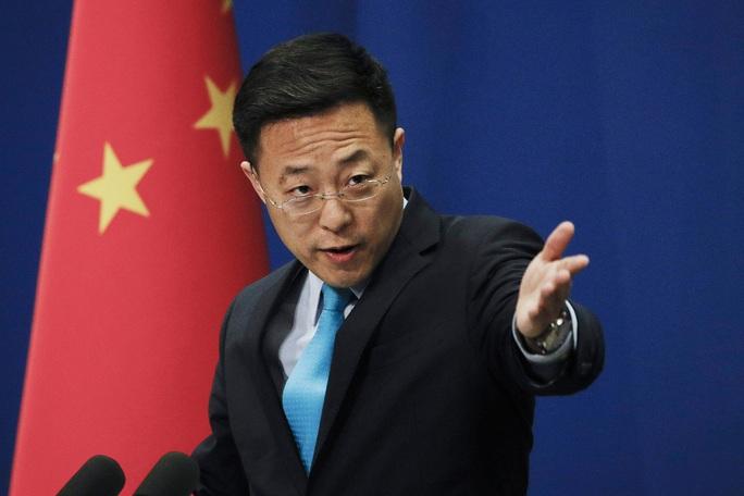 """Các nhà ngoại giao Trung Quốc """"xù lông"""" bảo vệ cuộc chiến chống Covid-19 - Ảnh 1."""
