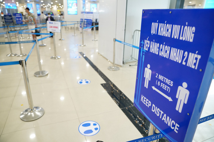 Chuyến bay tăng trở lại, sân bay Nội Bài thực hiện giãn cách ra sao? - Ảnh 4.