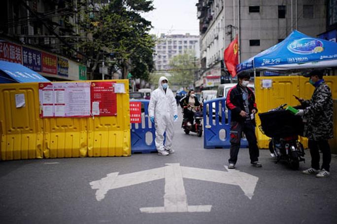 WHO mắc kẹt giữa cuộc đấu khẩu Mỹ - Trung - Ảnh 1.