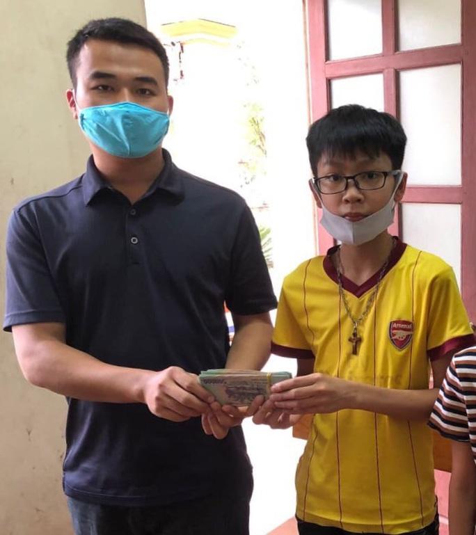 Nhặt được 50 triệu đồng, học sinh lớp 7 tìm trả lại cho cụ ông 89 tuổi - Ảnh 1.