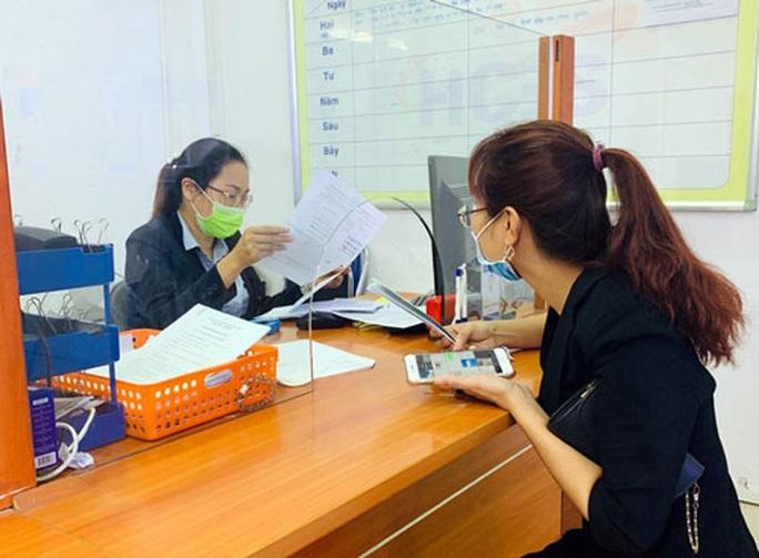 Hà Nội: Hướng dẫn tạm dừng đóng BHXH với các doanh nghiệp gặp khó khăn - Ảnh 1.