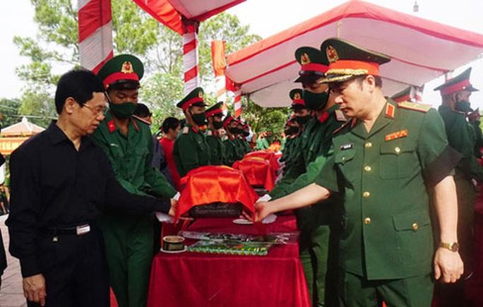 An táng hơn 12.000 hài cốt liệt sĩ hy sinh tại Lào - Ảnh 1.