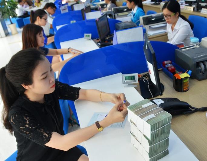 Ngân hàng Nhà nước yêu cầu giảm mạnh lãi suất tiền gửi và cho vay - Ảnh 1.