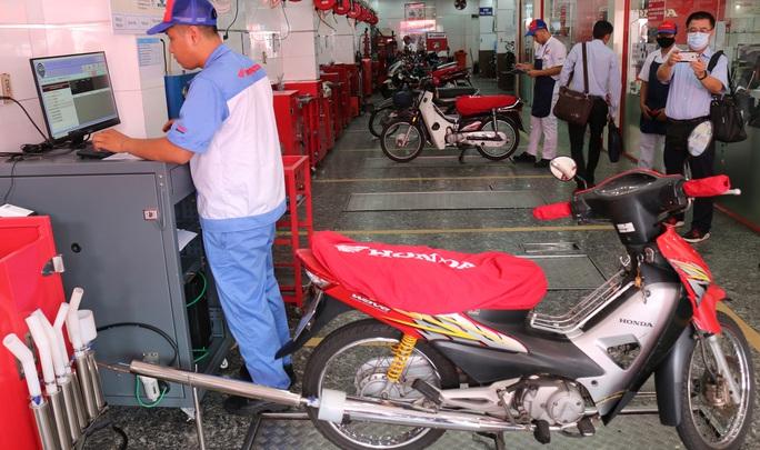 Người dân TP HCM được kiểm tra khí thải xe máy miễn phí - Ảnh 3.