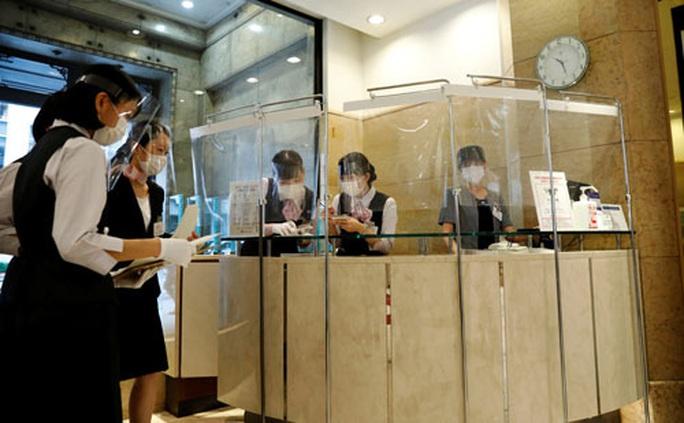 Nhật Bản suy thoái, Trung Quốc lao đao - Ảnh 1.