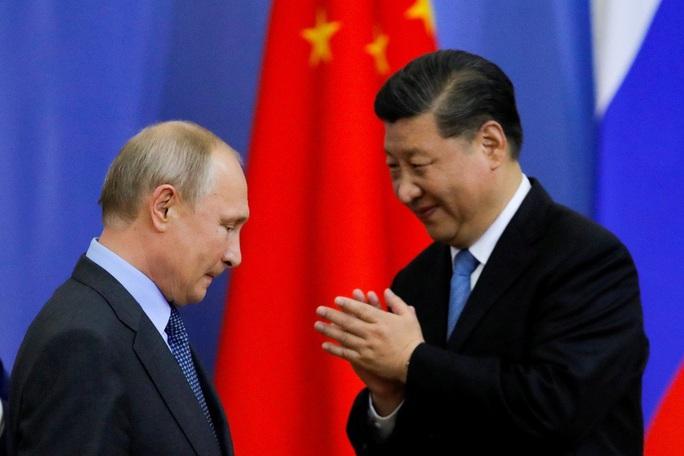 Covid-19 tạo áp lực lên quan hệ Nga - Trung - Ảnh 1.