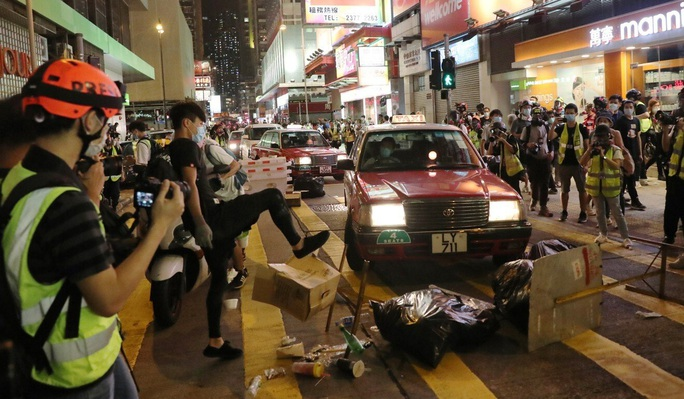 Mỹ trừng phạt Trung Quốc nhưng tránh tổn hại Hồng Kông? - Ảnh 3.