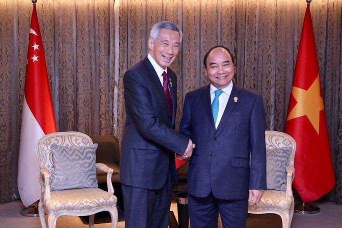 Thủ tướng Singapore ấn tượng với thành tích chống Covid-19 của Việt Nam - Ảnh 1.
