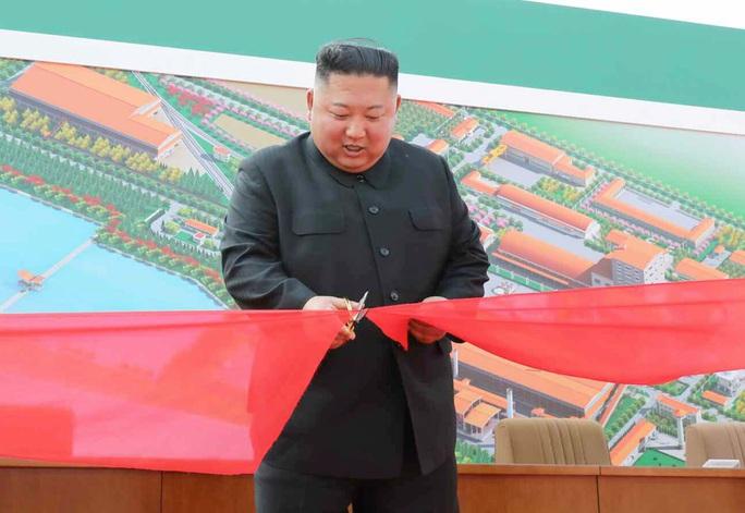 Hình ảnh mới về ông Kim Jong-un hé lộ điều gì? - Ảnh 1.