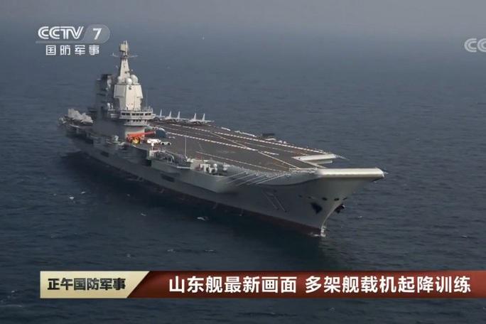 Trung Quốc chạy thử nghiệm tàu sân bay tự tạo đầu tiên - Ảnh 1.
