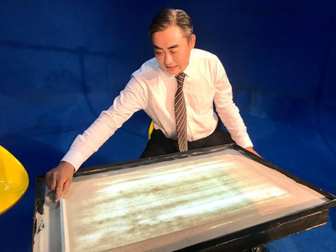 Cuộc chơi rối bóng với tranh cát của Đặng Trí Đức - Ảnh 1.