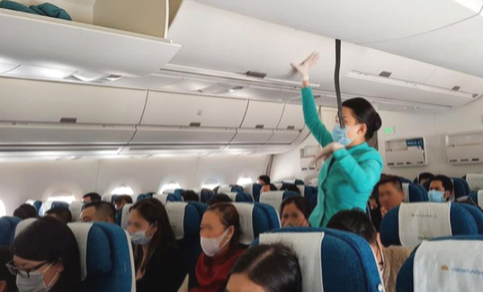 Bỏ quy định về giãn cách hành khách trên máy bay, xe buýt, taxi từ ngày mai 7-5 - Ảnh 1.