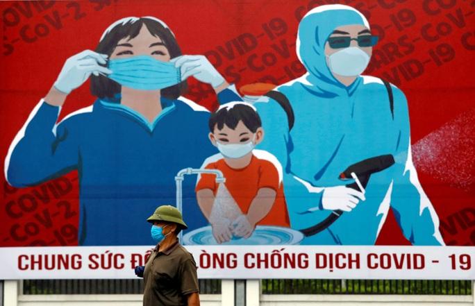 Việt Nam: Quốc gia chiến thắng hiếm hoi thời đại dịch - Ảnh 2.