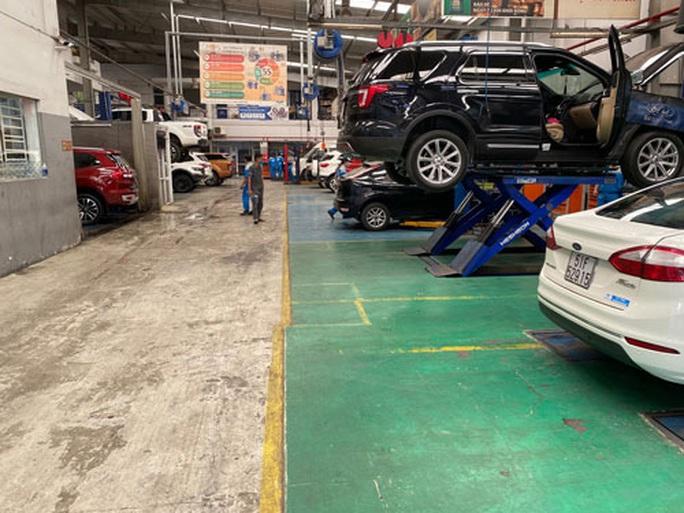 Gắn màng lọc khí thải cho xe: Người nghèo lo lắng - Ảnh 1.