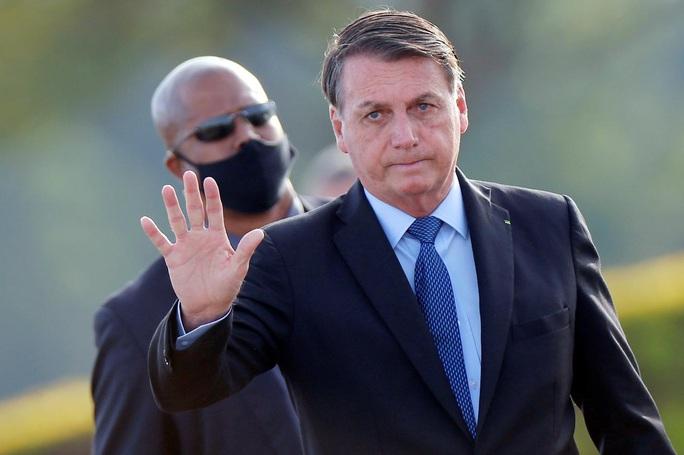 Brazil chưa hết sốt, tổng thống đối đầu với tòa án tối cao - Ảnh 1.