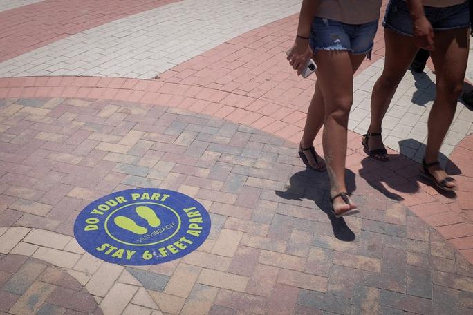Mỹ: 6 bang ghi nhận mức tăng Covid-19 cao kỷ lục - Ảnh 1.