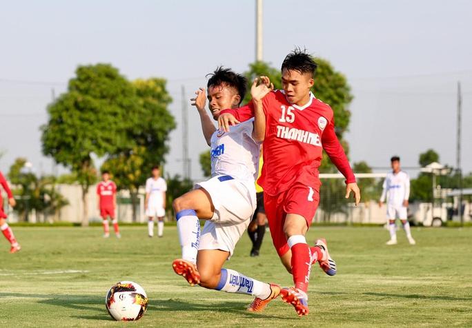 VCK U19 Quốc gia 2020: TP HCM gục ngã phút cuối, HAGL cầm hòa chủ nhà - Ảnh 1.