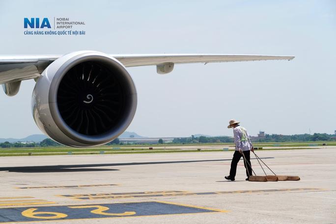 Đột nhập khu bay Nội Bài trong cái nắng nóng cực điểm hơn 62 độ C - Ảnh 29.