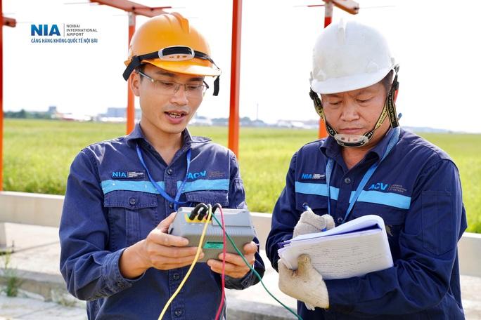 Đột nhập khu bay Nội Bài trong cái nắng nóng cực điểm hơn 62 độ C - Ảnh 30.