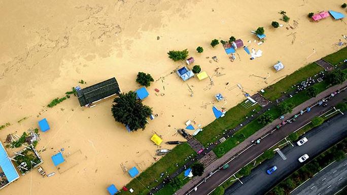 Trung Quốc: Lũ lụt lan tới 26 tỉnh, 81 người chết hoặc mất tích - Ảnh 1.