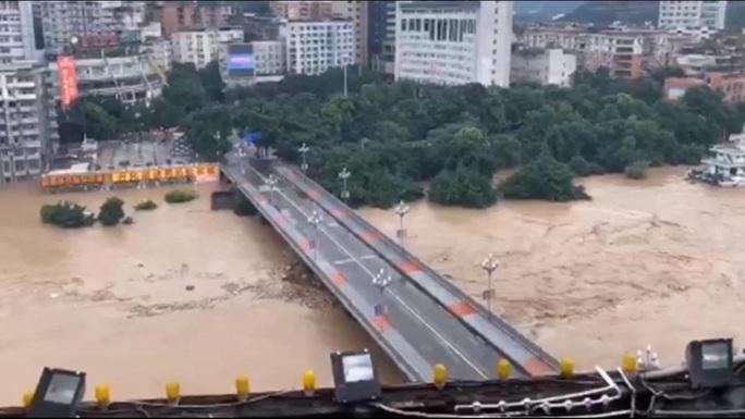 Trung Quốc: Lũ lụt lan tới 26 tỉnh, 81 người chết hoặc mất tích - Ảnh 4.