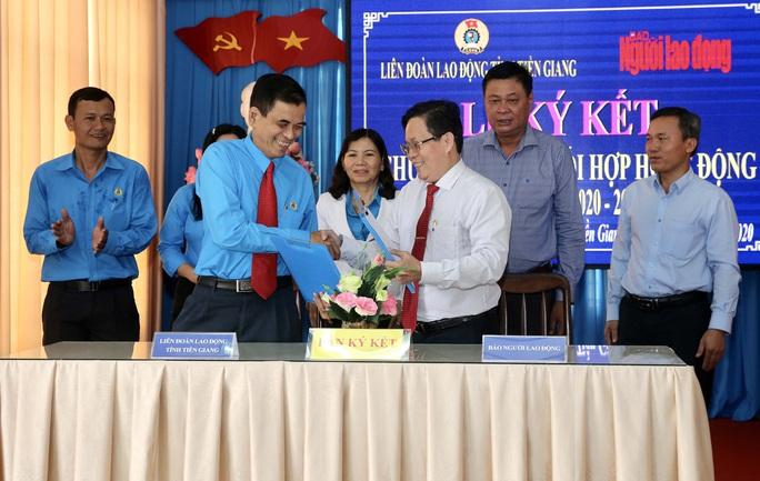 LĐLĐ Tiền Giang ký kết hợp tác với Báo Người Lao Động - Ảnh 1.