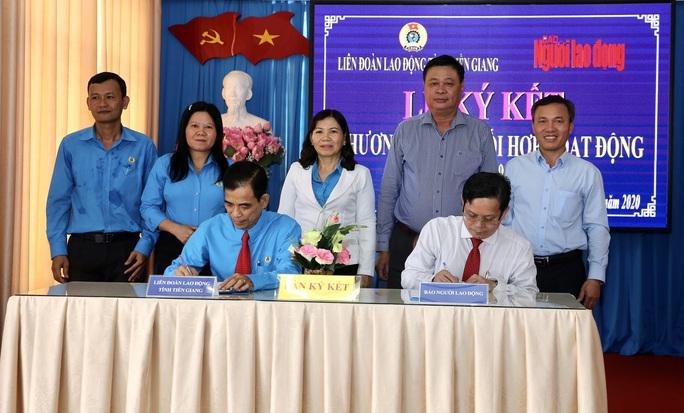 Báo Người Lao Động ký kết hợp tác với LĐLĐ tỉnh Tiền Giang - Ảnh 1.