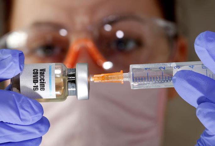 Cuộc đua vắc-xin Covid-19 thêm căng thẳng - Ảnh 1.