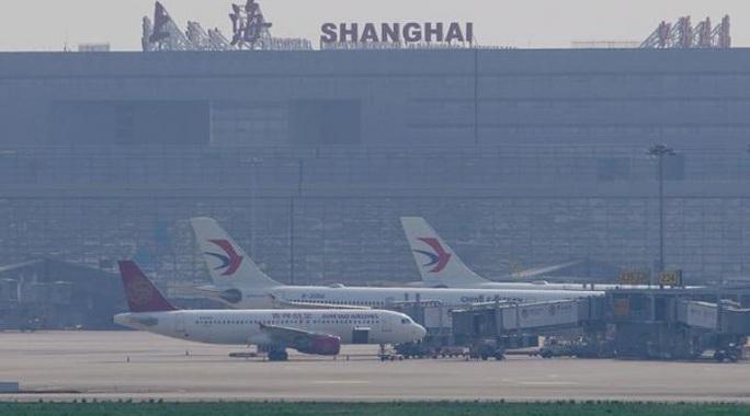"""Trung Quốc """"xuống nước"""", Mỹ nới lỏng lệnh cấm bay - Ảnh 1."""