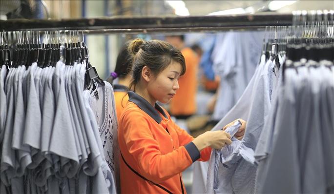 Việt Nam cam kết đấu tranh chống lao động cưỡng bức - Ảnh 1.