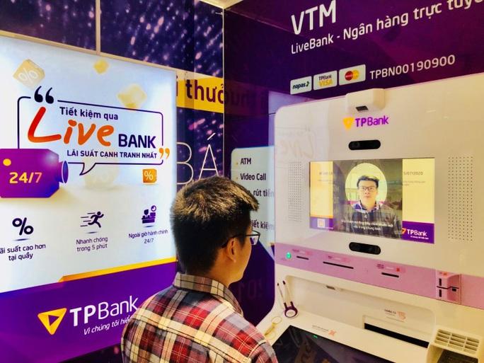 Ngân hàng Việt đầu tiên giao dịch bằng nhận diện khuôn mặt - Ảnh 1.