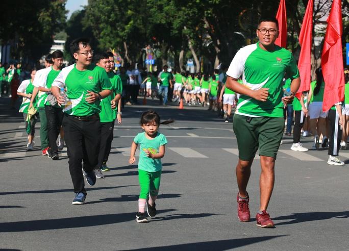 Rộn ràng ngày chạy Olympic TP HCM 2020, 8.000 người xuống phố - Ảnh 11.
