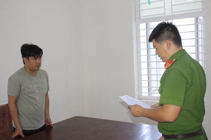Đà Nẵng: Bắt 2 đối tượng giả danh công an để nhận tiền chạy án - Ảnh 1.