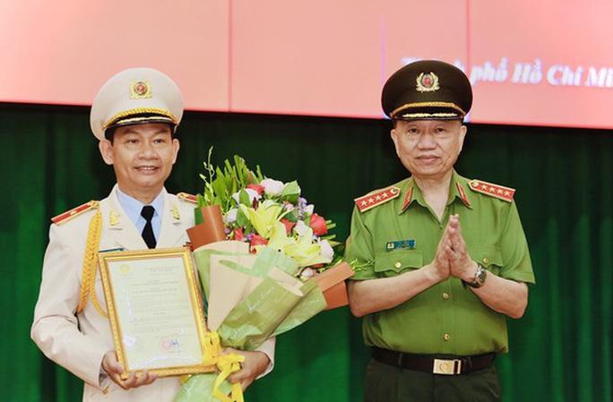 Phó Giám đốc Công an TP HCM Đinh Thanh Nhàn được thăng Thiếu tướng - Ảnh 1.