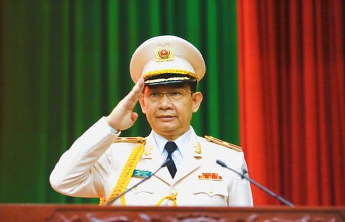 Phó Giám đốc Công an TP HCM Đinh Thanh Nhàn được thăng Thiếu tướng - Ảnh 3.