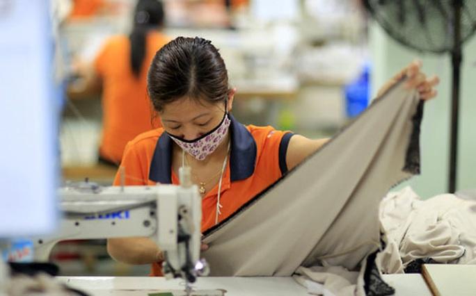Doanh nghiệp dệt may Việt Nam nỗ lực cải thiện việc làm - Ảnh 1.