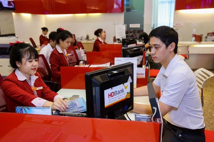 Nhiều ngân hàng được nới hạn mức cho vay - Ảnh 1.