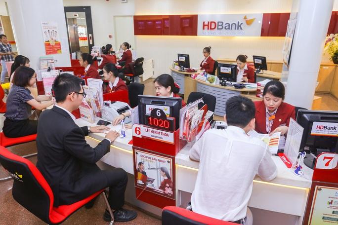 Nhiều ngân hàng được nới hạn mức cho vay - Ảnh 2.