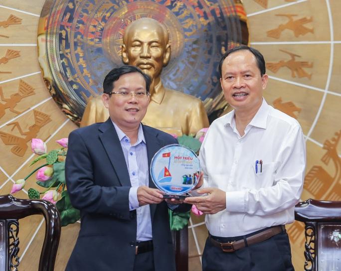 Thanh Hóa và Báo Người Lao Động trao đổi, hợp tác trên nhiều lĩnh vực - Ảnh 4.