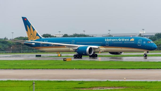Vietnam Airlines bay chuyến chở khách đầu tiên đến Trung Quốc sau dịch - Ảnh 3.