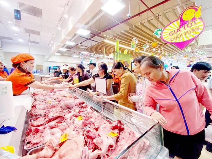 Thịt heo giảm giá 15% - Ảnh 1.