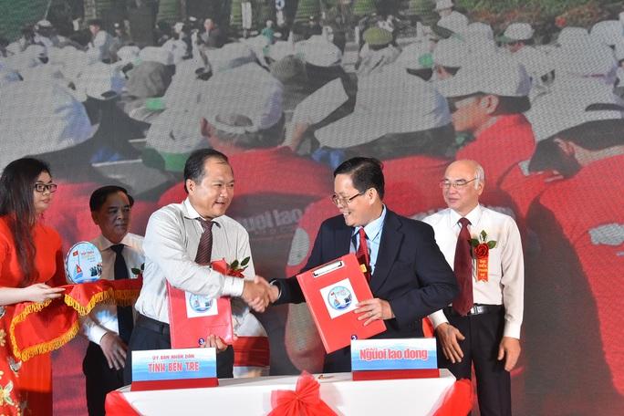 Báo Người Lao Động ký kết Quy chế phối hợp với Bộ Tư lệnh Cảnh sát Biển - Ảnh 4.