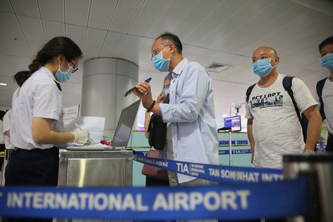 TP HCM: 33 người ở quận 11 trở về TP từ Đà Nẵng vào tối nay - Ảnh 1.
